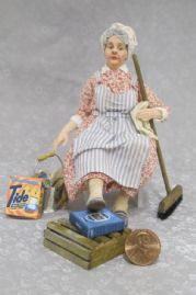 Dusty Doris Seated Cleaning Lady